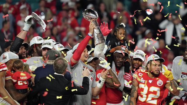 Feb 2, 2020; Miami Gardens, Florida, USA; Kansas City Chiefs quarterback Patrick Mahomes (15) hoist the Vince Lombardi Trophy after defeating the San Francisco 49ers in Super Bowl LIV at Hard Rock Stadium. Mandatory Credit: Kirby Lee-USA TODAY Sports