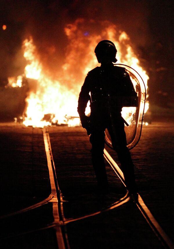 Полицейский в Лиссабоне во время всеобщей забастовки