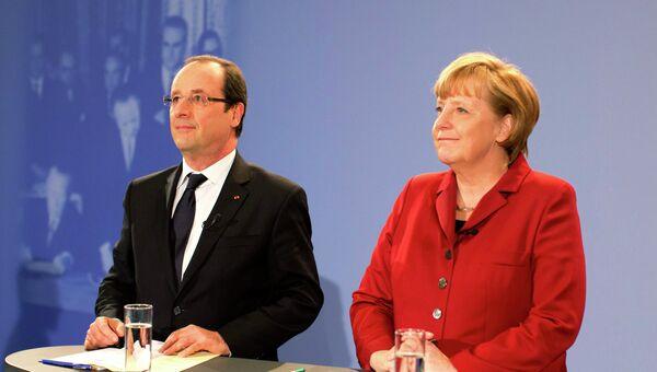 Франсуа Олланд и Ангела Меркель на встрече со студентами в рамках празднования юбилея Елисейского договора