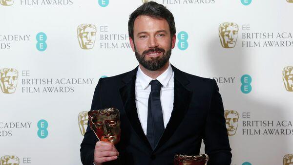 Бен Аффлек с наградами BAFTA за фильм Операция Арго