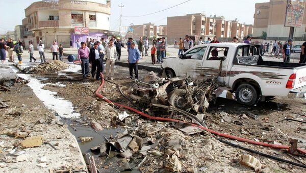 Последствия взрыва автомобиля в городе Киркук