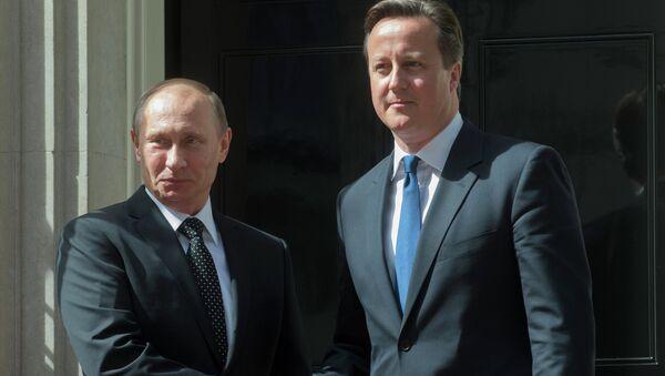 Президент России Владимир Путин и премьер-министр Великобритании Дэвид Кэмерон, архивное фото