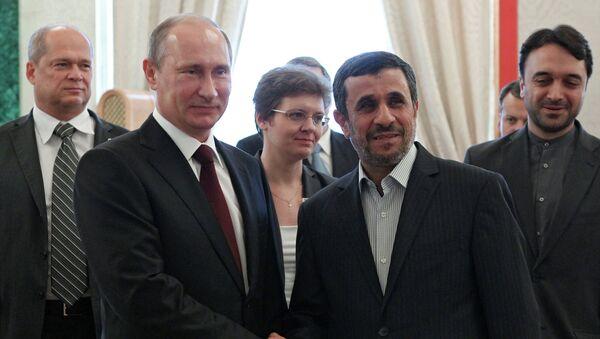 Президент России Владимир Путин и президент Исламской Республики Ирак Махмуд Ахмадинежад (слева направо на первом плане)