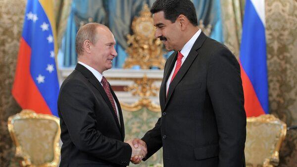 Президент России Владимир Путин и президент Боливарианской Республики Венесуэла Николас Мадуро