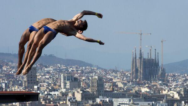 Саша Кляйн и Патрик Хаусдинг (Германия) в синхронных прыжках в воду