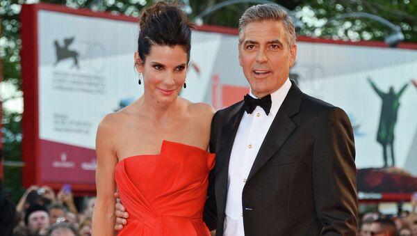 Актеры Сандра Баллок и Джордж Клуни на церемонии открытия 70-го Венецианского международного кинофестиваля