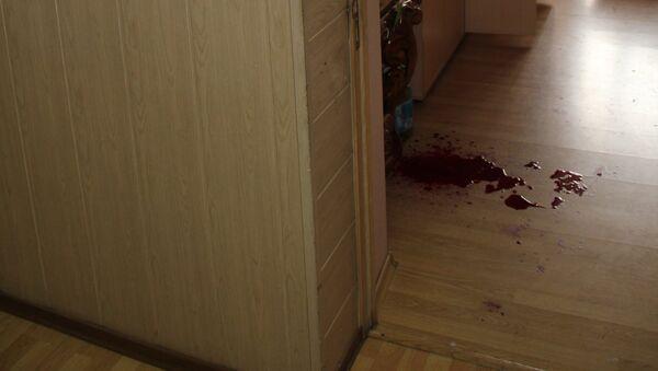 Неизвестный ранил двоих и двоих облил бензином в офисе Владивостока, архивное фото