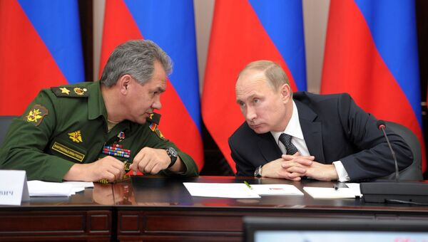 Президент России Владимир Путин и министр обороны Сергей Шойгу. Архивное фото