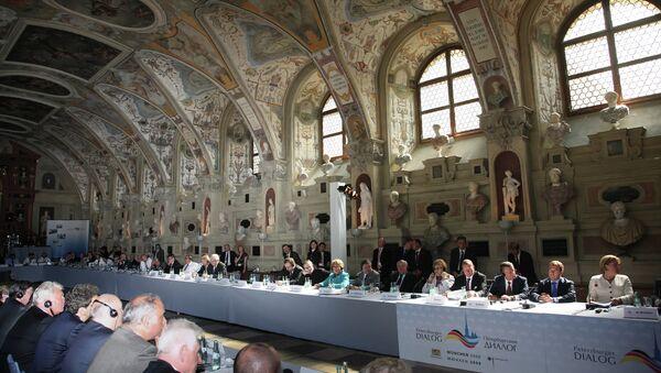 Лидеры России и Германии на заседании Петербургский диалог в Мюнхене. Архивное фото