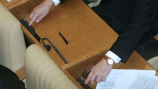 Во время голосования на последнем пленарном заседании Государственной Думы РФ 4-го созыва.