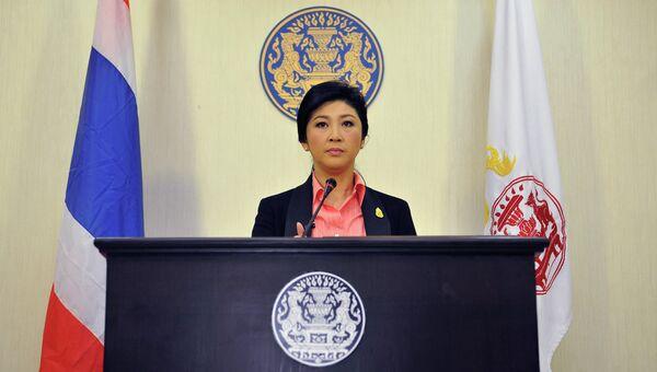 Премьер-министр Таиланда Йинглак Чинават во время пресс-конференции в Бангкоке. 9 декабря 2013