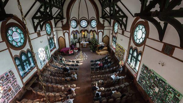 Прихожане лютеранской церкви Святого Павла во Владивостоке собираются на Рождественскую службу