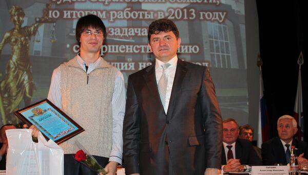 Собкор РИА Новости Эдуард Демьянец победил в конкурсе по освещению работы судов в Саратовской области . Событийное фото