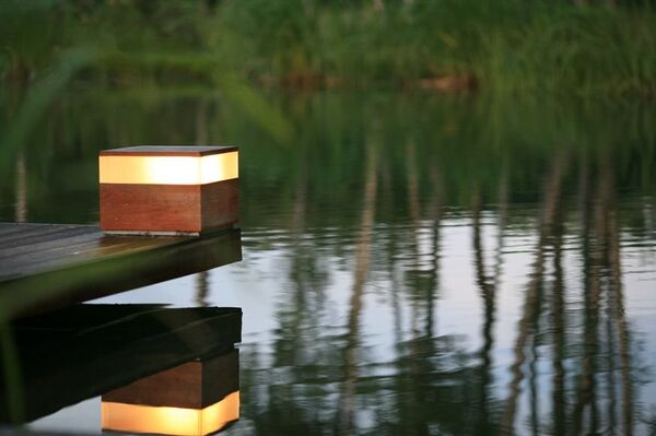 Красоту ничем не спрячешь: 8 правил ночного освещения дома и участка