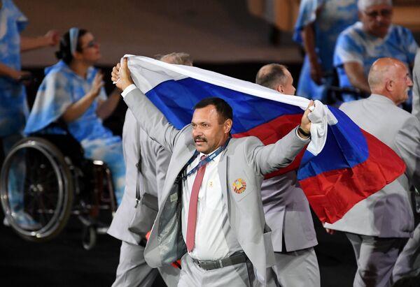 Андрей Фомочкин с флагом России
