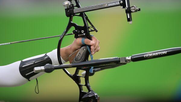 Спортсменка в командном первенстве среди женщин по стрельбе из лука