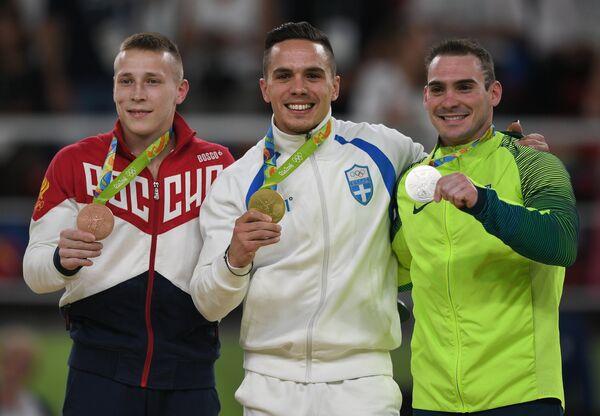 Денис Аблязин - бронзовая медаль, Элефтериос Петруниас - золотая медаль, Артур Дзанетти - серебряная медаль (слева направо)