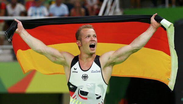 Немецкий гимнаст Фабиан Хамбюхен