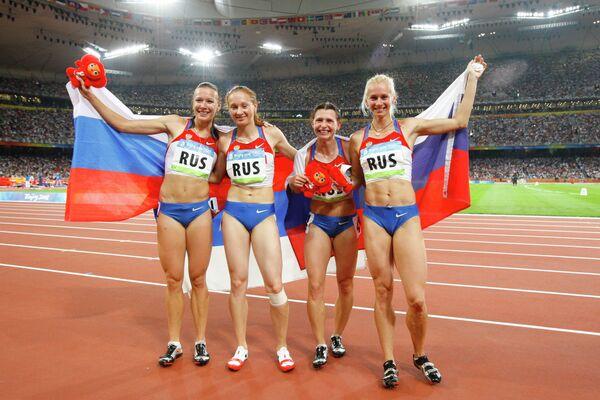 Российские бегуньи Юлия Чермошанская, Александра Федорива, Евгения Полякова, Юлия Гущина (слева направо)