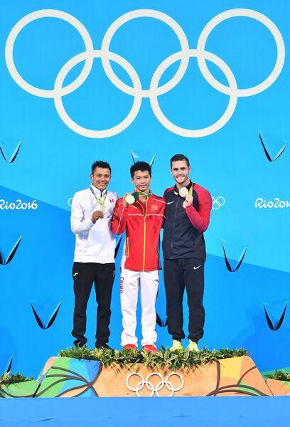 Призеры Олимпийских игр в прыжках в воду с вышки Герман Санчес, Чэнь Айсэнь и Дэвид Будайя (слева направо)