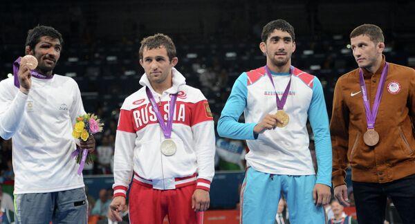 Йогешвар Дутт, Бесик Кудухов, Тогрул Асгаров и Коулмен Скотт (слева направо)