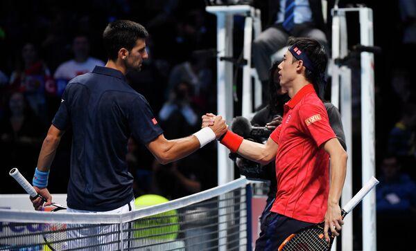 Сербский теннисист Новак Джокович и японец Кэй Нисикори (слева направо)
