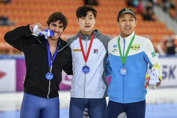 Тибо Фоконне, Лим Йонгджин и Нурберген Жумагазиев (слева направо)