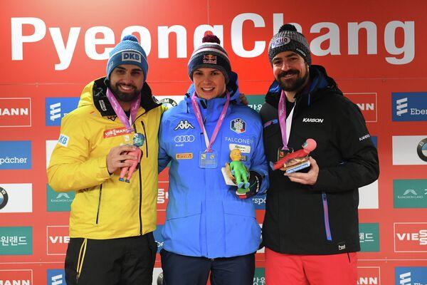 Анди Лангенхан (Германия), Доминик Фишналлер (Италия) и Самуэль Эдни (Канада) (слева направо)