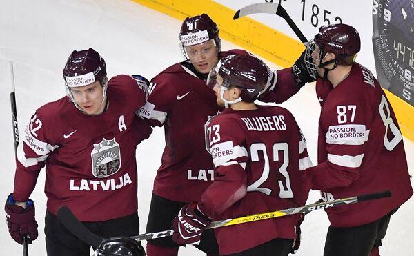 Игроки сборной Латвии Артур Кулда, Рональд Кениньш, Теодор Блюгерс и Гинтс Мейя (слева направо)