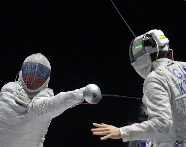 Слева направо: Алексей Якименко (Россия) и Гу Бонжил (Республика Корея)
