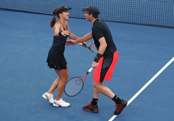 Швейцарская теннисистка Мартина Хингис и британец Джейми Маррей (слева направо)