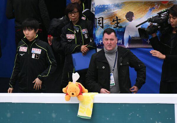 Юдзуру Ханю и Брайан Орсер (справа)