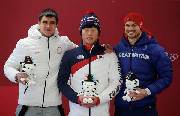 Никита Трегубов, Юн Сунбин и Доминик Парсонс (слева направо)