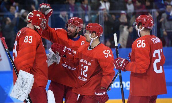 Хоккеисты сборной России Василий Кошечкин, Илья Ковальчук, Сергей Широков и Вячеслав Войнов (слева направо)