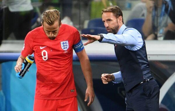 Форвард сборной Англии Гарри Кейн и главный тренер сборной Англии Гарет Саутгейт (Слева направо)