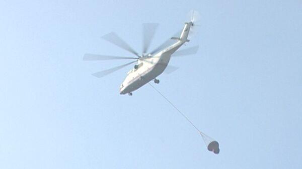 Вертолеты прибыли на помощь пожарным на горящий стадион в Солнечногорске