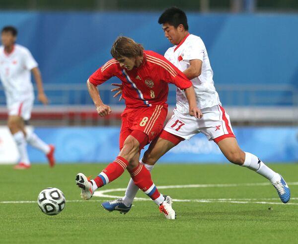 Игровой момент матча студенческих команд России и Китая