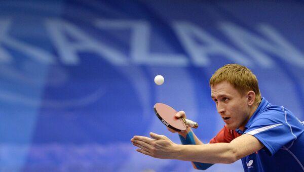 Вячеслав Буров (Россия) в матче предварительного раунда группового этапа одиночного разряда мужского турнира по настольному теннису