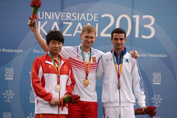 Ли Юэхун, Леонид Екимов и Клеман Бессаже (слева направо)