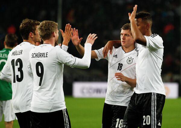 Футболисты сборной Германии Томас Мюллер, Андре Шюррле, Жером Боатенг