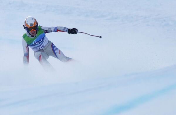 Российский горнолыжник Иван Францев (на втором плане)