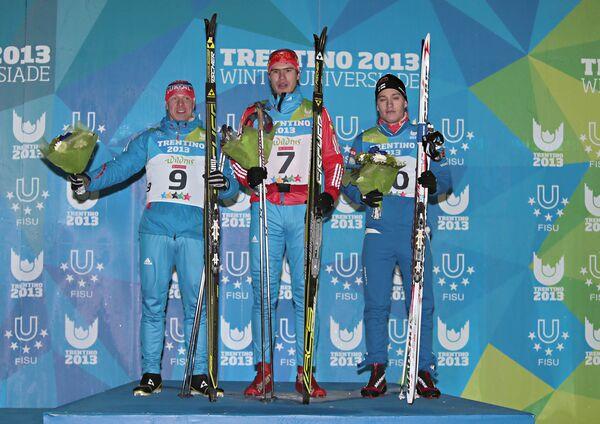 Российские лыжники Павел Сюлатов (серебряная медаль), Максим Ковалев (золотая медаль)