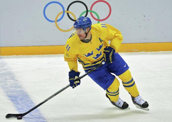 Даниэль Альфредссон (Швеция) в матче группового этапа между сборными командами Швеции и Швейцарии