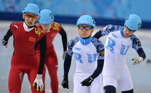 Дацзин У (Китай), Тянью Хань (Китай), Виктор Ан (Россия) и Семен Елистратов (Россия) (слева направо)