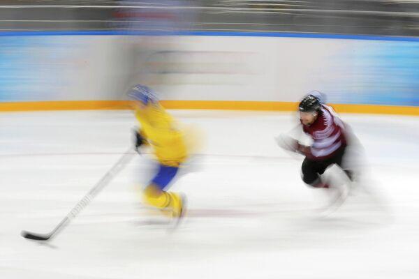 Игровой момент матча Швеция - Латвия