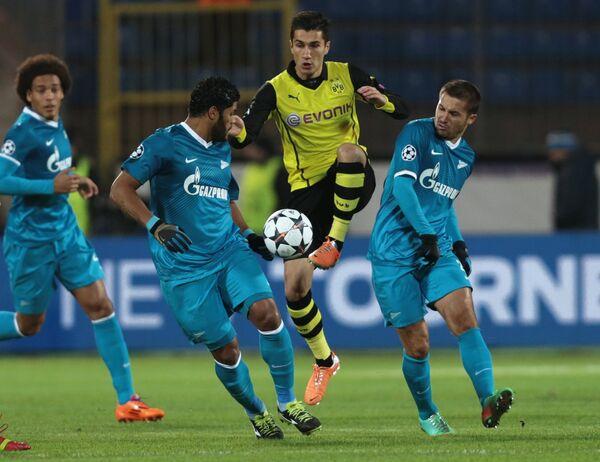 Футболисты Зенита Аксель Витсель, Халк и Виктор Файзулин в матче с Боруссией