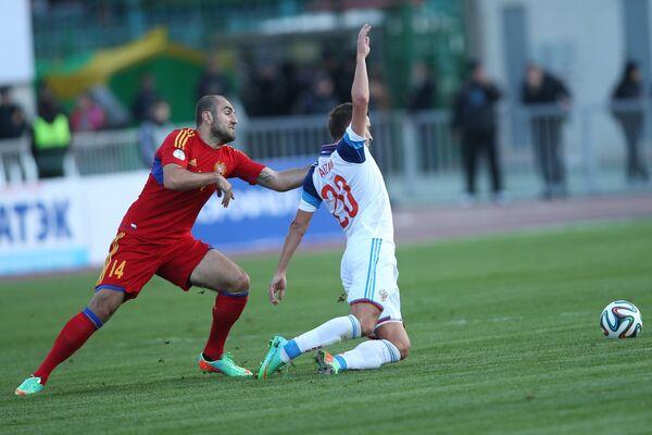 Игровой момент матча сборных России и Армении
