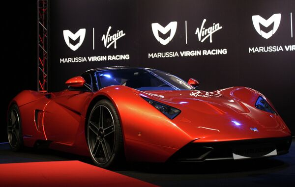 Спорткар MARUSSIA B1 компании Маруся Моторс демонстрируется на презентационом стенде