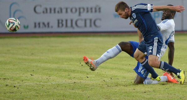 Игровой момент матча Волга - Динамо