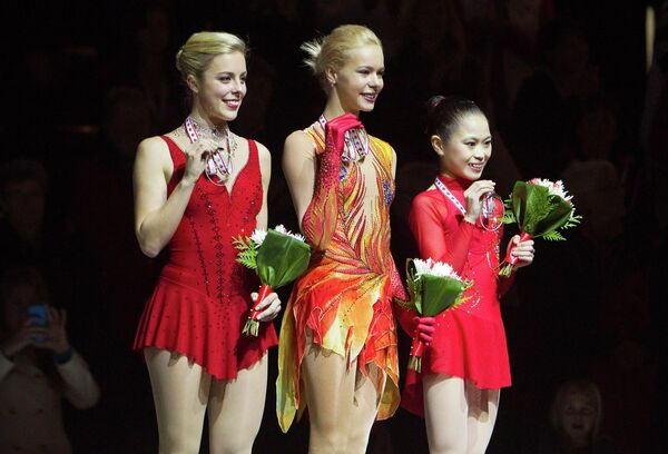 Американка Эшли Вагнер, российская фигуристка Анна Погорилая и японка Сатоко Мияхара